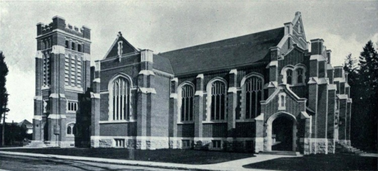 Black and white photo of St. Giles church in Hamilton, Ontario. The photo shows its west elevation in 1916, shortly after its construction. It is a neo-gothic brick chuch, with detailed tracery, a square tower, and beautiful windows.