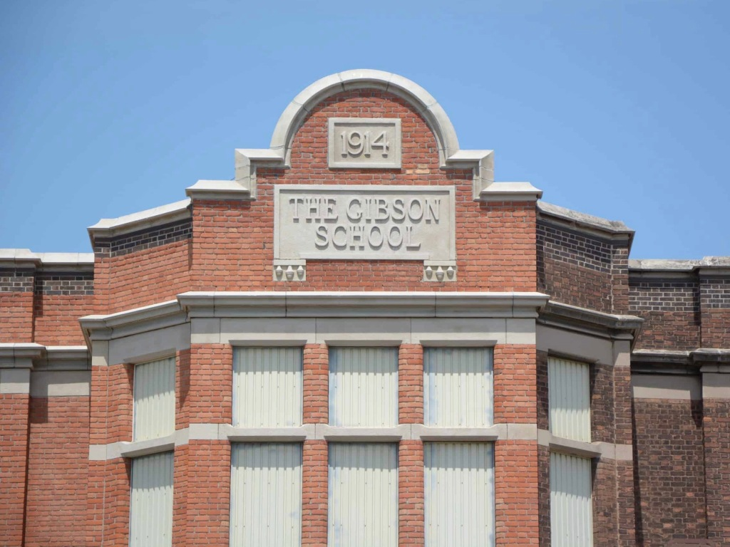 Central parapet of the Gibson School with datestone and school name